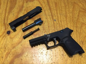 The Sig Sauer P320 Compact field stripped...